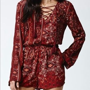 Kendall and Kylie Long Sleeve Lace Up Romper